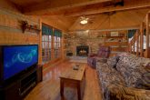 Cozy cabin with fireplace and sleeper sofa
