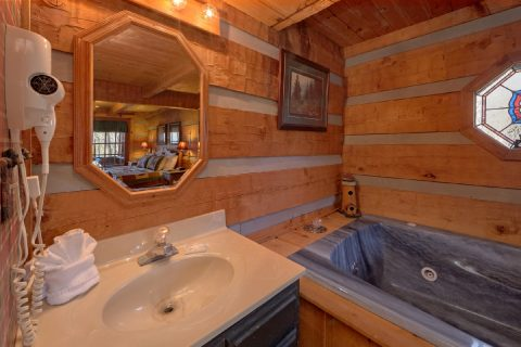 Master bedroom with King bed and Jacuzzi Tub - A Bear Adventure