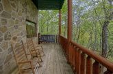 2 bedroom cabin with porch swing and wooded view
