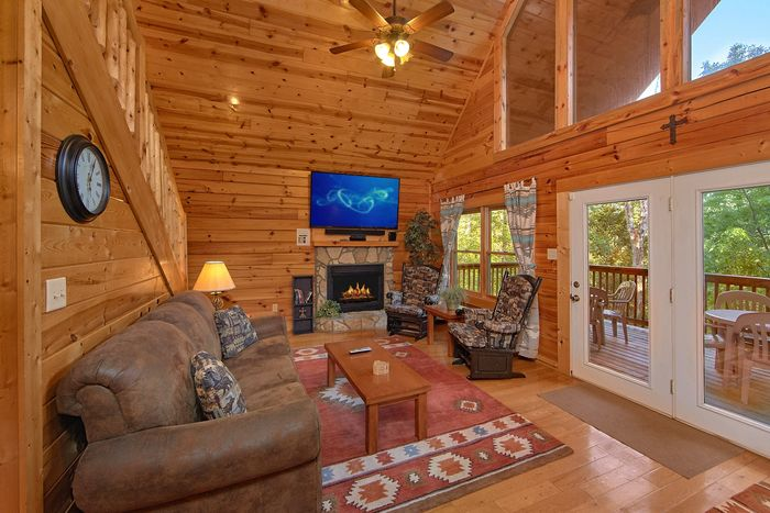 Living Room with Surround Sound and Fireplace - A Perfect Stay