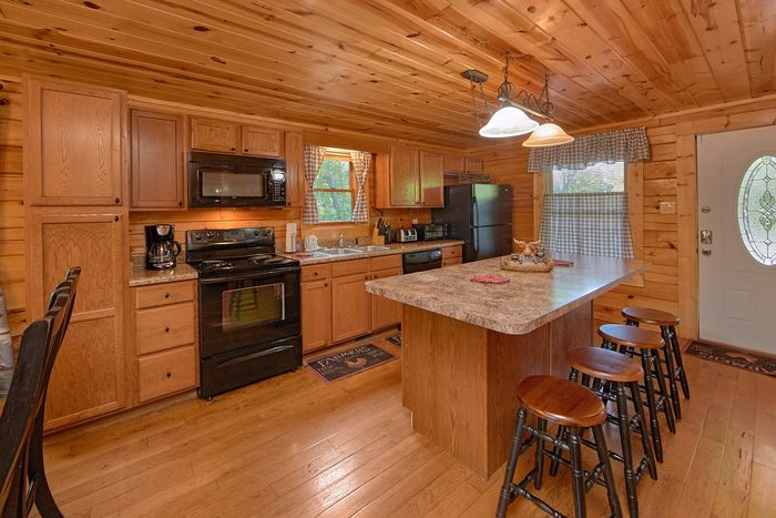 Fully Equipped Kitchen with Bar Seating - A Perfect Stay