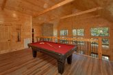 Cabin on the river with a pool table and theater