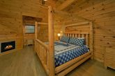 Luxurious cabin master Bedroom with fireplace