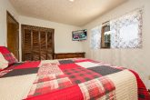 Queen bedroom with TV in 3 bedroom rental