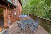 Cabin with wooded view and hot tub on deck