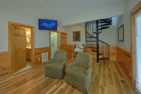 Cabin master bedroom with recliners and large TV - Angel Haven