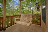 1 bedroom cabin with porch swing and hot tub