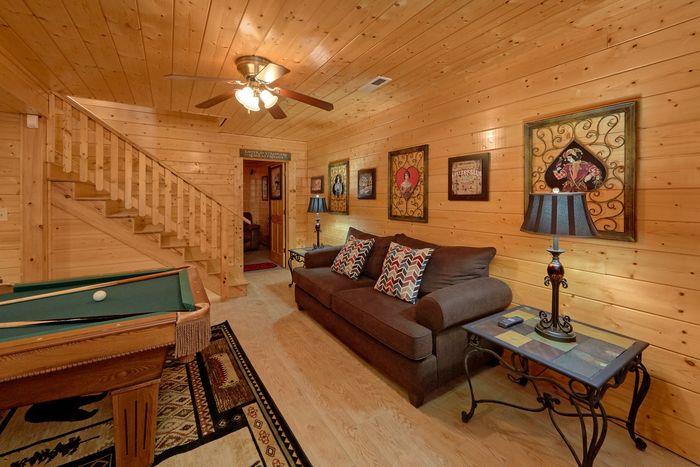Game room with sleeper sofa and pool table - April's Diamond