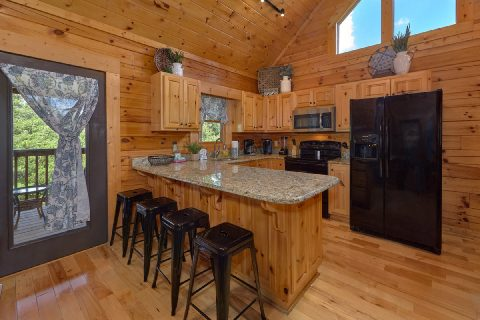 Fully stocked kitchen in cabin rental - Autumn Breeze