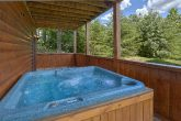 Private hot tub at cabin with wooded view