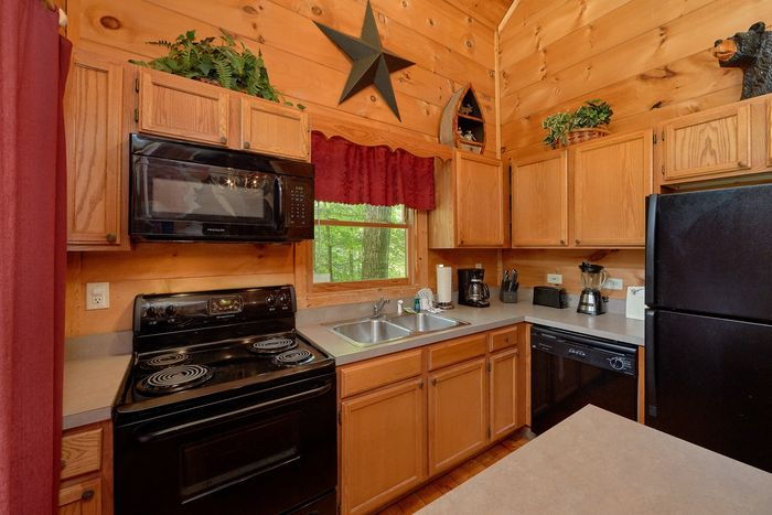 Fully Stocked Kitchen in 2 bedroom cabin - Bar None