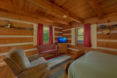 Master Bedroom with Chair and Flatscreen TV - Bear Cove Escape