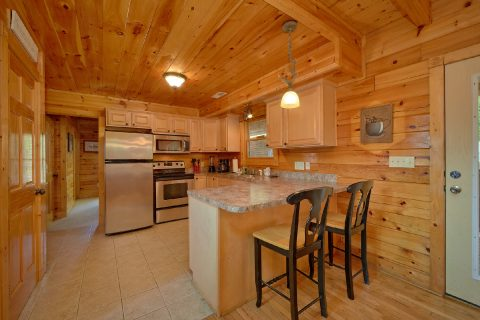 Kitchen in 3 bedrom cabin with bar seating - Bear Mountain Lodge