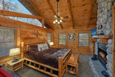 Master bedroom with King bed and Fireplace - Bear Paw Bridge