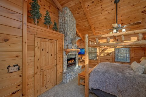 Master Bedroom in cabin with private fireplace - Bear Paw Bridge