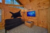 TV and Arcade Game in luxury cabin bedroom