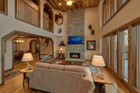Spacious Living Room with Fireplace and View - Bluff Mountain Lodge