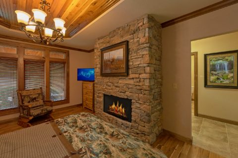 Queen bedroom with fireplace in 6 bedroom cabin - Bluff Mountain Lodge