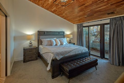 Cabin Master Bedroom with King bed and fireplace - Bluff Mountain Lodge