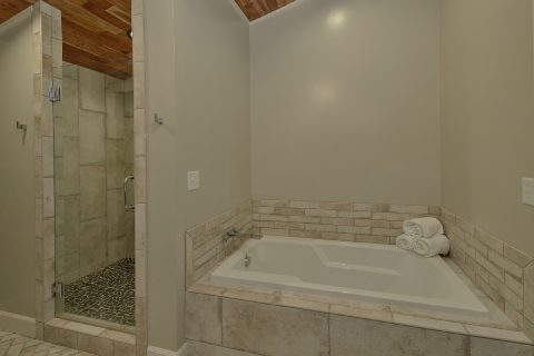 Luxurious Tub and Shower in Master Bath in cabin - Bluff Mountain Lodge