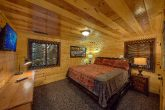 Queen bedroom with TV in Bluff Mountain cottage