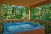Resort Cabin with Hot Tub and Wooded View