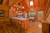 Cabin with hand hewn logs and stocked kitchen