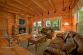 Cabin with stone fireplace and living room