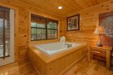 Master Bedroom with Jacuzzi Tub in large cabin