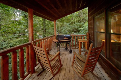 Covered Deck with Rocking Chairs and Grill - Endless Joy