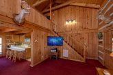 Spacious living room with TV in 2 bedroom cabin