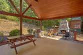 Cabin with outdoor fireplace and picnic table