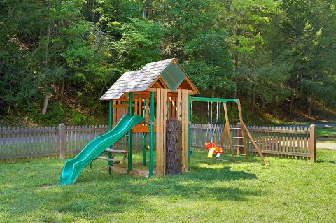 Resort playground and pool with 4 Bedroom cabin - Hillbilly Hideaway