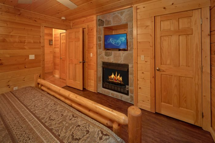 Master Bedroom with Fireplace Lower Level - In The Heart Of Pigeon Forge