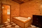Jacuzzi Tub 8 Bedroom Cabin Sleeps 28