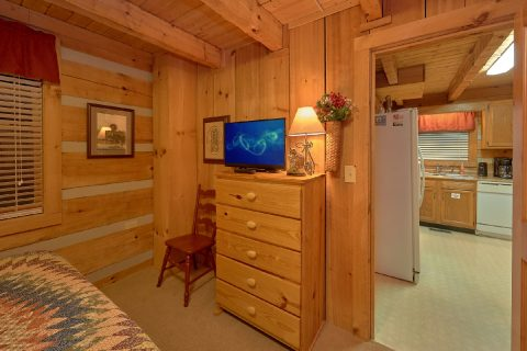 King bedroom with TV in Rustic cabin - Just Barely Making It