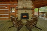 Rustic Cabin with outdoor fireplace and rockers