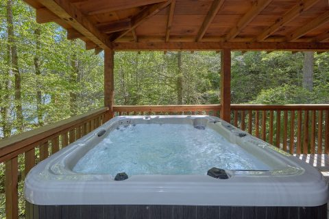 Cabin with private hot tub and fireplace on deck - Kicked Back Creekside