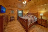 Master bedroom with king bed in 3 bedroom cabin