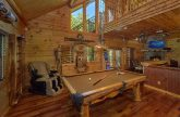 Cabin Game Room with pool table and arcade
