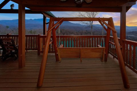 Porch swings and Rockers at cabin with Views - Majestic Point Lodge