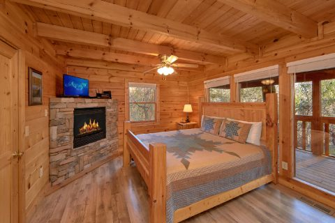 2 Bedroom Cabin Master Bedroom with Fireplace - Making More Memories