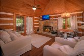 Rustic Cabin with Stone Fireplace and TV