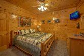 Spacious King Bedroom with TV in 5 bedroom cabin