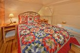 Cabin with queen bed and corner jacuzzi