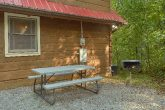 Rustic Gatlinburg cabin with picnic table