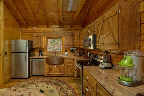 Kitchen with granite counters in 2 bedroom cabin - River Edge