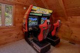 Cabin on the River with Race Car Arcade Games