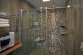 Cabin on the River with beautiful stone shower