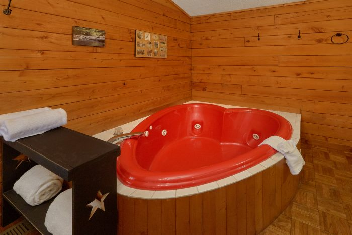 Heart shaped Jacuzzi Tub in 1 Bedroom Cabin - River Rush